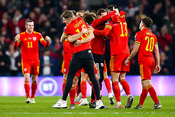 David Brooks (in a Lockyer 16 shirt) hugs Tom Lockyer of Wales after Wales win 2-0 to secure their qualification for Euro 2020 - Rogan/JMP - 19/11/2019 - FOOTBALL - Cardiff City Stadium - Cardiff, Wales - Wales v Hungary - UEFA Euro 2020 Qualifiers.