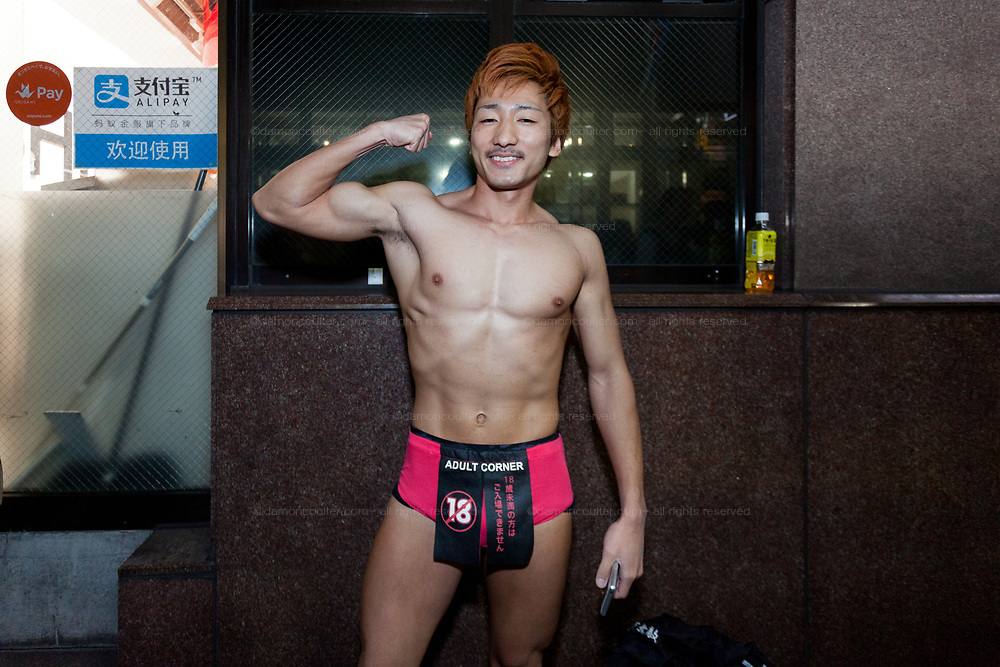 A muscular Japanese man wears briefs with a Adult corner curtain on them during the Halloween celebrations in Shibuya, Tokyo, Japan. Wednesday October 31st 2018 .  Halloween has grown massively popular  in Japan over the last few yers. Primarily an event for young adults who use it as a chance to dress up in inventive costumes and spend the night partying . In recent years the misbehaviour of some revellers has caused a heavier police presence on the street and  a push back from the Japanese society, and media  who see no need for nor benefits to this western cultural import.
