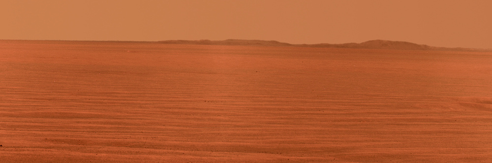 NASA's Mars Exploration Rover Opportunity used its panoramic camera to record this eastward horizon view on the 2,407th Martian day, or sol, of the rover's work on Mars (Oct. 31, 2010).