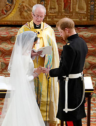 Prince Harry and Meghan Markle exchange rings in St George's Chapel at Windsor Castle during their wedding service, conducted by the Archbishop of Canterbury Justin Welby.