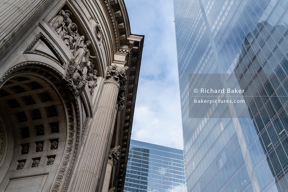 The arch and figures of heritage architecture beneath the high-rise modernity of the recently-completed 22 Bishopsgate in the 'City of London', the capital's financial district, aka The Square Mile, on 2nd February 2021, in London, England.