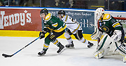 Powell River King Johan Steen skates away from Victoria Grizzlies Tyler Welsh at the Q Centre in  Colwood, British Columbia Canada on March 27, 2017.