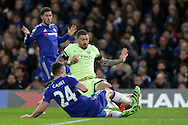 Gary Cahill of Chelsea and Aleksandar Kolarov of Manchester City both slide in for the ball. The Emirates FA Cup, 5th round match, Chelsea v Manchester city at Stamford Bridge in London on Sunday 21st Feb 2016.<br /> pic by John Patrick Fletcher, Andrew Orchard sports photography.