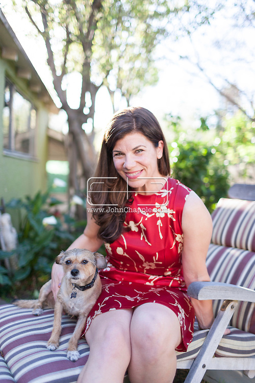 """March 12, 2015. Los Angeles, California.  Author Robin Rinaldi, who has written a memoir """"The Wild Oats Project"""" about how she spent a year in an open marriage, having sex with various different men, as a way of finding sexual fulfillment as a woman. Robin is pictured with her dog, Tengo.<br /> Photo Copyright John Chapple / www.JohnChapple.com /"""