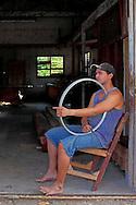 Man with wheel in Pinar del Rio, Cuba.