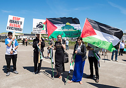 © Licensed to London News Pictures; 12/06/2021; Hayle, Cornwall UK. G7 summit in Cornwall. Supporters of Palestine against Israeli evictions of Palestinians hold flags at the Resist G7 coalition of protest groups protest in Hayle on the second day of the G7 summit. The protest included supporters of Palestine and of Kashmir as well as anti-war groups and socialists and trade unionists. Photo credit: Simon Chapman/LNP.