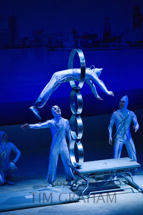 Members of the Shanghai Acrobatic Group performing on stage at the Shanghai Centre Theatre, China