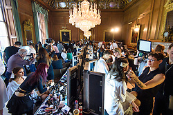 Models prepare backstage for the Julien Macdonald Autumn/Winter 2017 London Fashion Week show at Goldsmith's Hall, London.