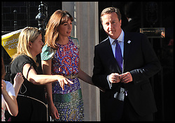 The Prime Minister David Cameron and his wife Samantha with his head of Operations Liz Sugg look on as Kate Nesbitt MC arrives in Downing St, with the Olympic torch relay on the eve of the Olympic games, Thursday July 26, 2012. Photo by Andrew Parsons/i-Images.All Rights Reserved ©Andrew Parsons.See Instructions