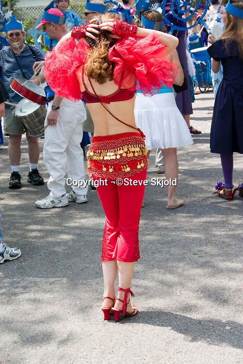 Performer in red costume. In the Heart of the Beast May Day Festival and Parade Minneapolis Minnesota USA