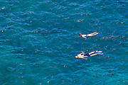 Snorkelers in the blue Pacific waters at Hideaways Beach, Princeville, Island of Kauai, Hawaii