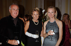 Left to right, MR & MRS PAUL MYNERS he is chairman of Marks & Spencer and the COUNTESS OF DERBY at a party hosted by Dom Perignon and Vanity Fair magazine to celebrate the launch of a unique collection of essays based on the theme of seduction to raise money for the charity English Pen. The paty was held at the Dom Perignon Mallroom,  13 Grosvenor Crescent, London W1 on 8th September 2004.