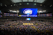 Players line up on the court during the National Anthem of the NCAA South Regionals between the University of Michigan Wolverines and the University of Kansas Jayhawks at Cowboys Stadium in Arlington on Friday, March 29, 2013. (Cooper Neill/The Dallas Morning News)