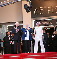 Georges Lautner (center) at The Paperboy gala screening red carpet at the 65th Cannes Film Festival France. Thursday 24th May 2012 in Cannes Film Festival, France.