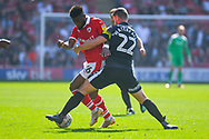 Mamadou Thiam of Barnsley (26) and Luke Waterfall of Shrewsbury Town (22) in action during the EFL Sky Bet League 1 match between Barnsley and Shrewsbury Town at Oakwell, Barnsley, England on 19 April 2019.