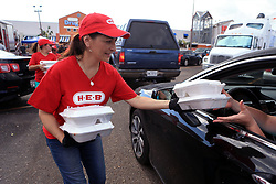 August 29, 2017 - Rockport, Texas, U.S.- H-E-B employee MICHELLE AQUAS distributes meals to Aransas Pass residents from H-E-B's Disaster Response Unit on Tuesday. (Credit Image: © Rachel Denny Clow/TNS via ZUMA Wire)