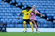 Trudi Carter (#18) of Jamaica wrestles control of the ball from Kirsty Smith (#2) of Scotland during the International Friendly match between Scotland Women and Jamaica Women at Hampden Park, Glasgow, United Kingdom on 28 May 2019.