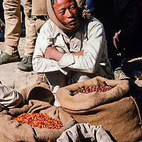 A lowland farmer sells his wares at the weekly market in Namche Bazar in the Khumbu region of Nepal 1986.