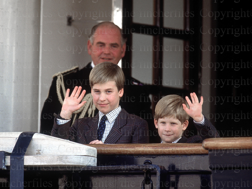 Prince William and Prince Harry seen with Admiral Robert Woodward on the deck of the Royal Yacht Britannia moored in Toronto,Canada in October 1991. Photograph by Jayne Fincher