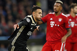 (l-r) aj1Noussair Mazraoui of Ajax, Jerome Boateng of FC Bayern Munchen during the UEFA Champions League group E match between Bayern Munich and Ajax Amsterdam at the Allianz Arena on October 02, 2018 in Munich, Germany