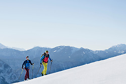Skiers climbing on snow mountain
