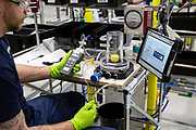 """Mcc0095062 . Daily Telegraph<br /> <br /> The Absorber line .<br /> <br /> An Absorber for a Penlon ventilator being tested .<br /> <br /> Airbus employees at AMRC Cymru manufacturing parts for the VentilatorChallengeUK consortium which includes corporate names including Airbus, Rolls-Royce and McLaren.  The consortium has supplied 250 ventilators to hospitals, with """"hundreds"""" to follow this week and maximum output slated for early May.<br /> AMRC Cymru is a purpose built research and development facility close to the Airbus wing-manufacturing plant in Broughton, North Wales . 500 operators in total are working around the clock who normally work in aerospace manufacturing and are now building Absorbers and Flow meters for the Penlon Ventilator . <br /> <br /> <br /> <br /> Broughton 22 April 2020"""