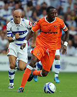 Fotball<br /> England<br /> 08.08.2009<br /> Foto: Fotosports/Digitalsport<br /> NORWAY ONLY<br /> <br /> QPR FC vs Blackpool FC Championship 08/08/09<br /> <br /> Blackpool's Jason Euell gets away from Gavoin Mahon of QPR.