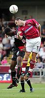 Fotball<br /> Foto: SBI/Digitalsport<br /> NORWAY ONLY<br /> <br /> Northampton v Leyton Orient<br /> Coca-Cola Football League 2<br /> Sixfields Stadium.<br /> 28/08/2004<br /> <br /> Leyton Orient's Gabriel Zakuani goes for the ball with Northampton's Scott Mcgleish
