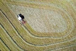 THEMENBILD - Landwirt beim zusammen fassen des Heu zu einer Schwade mit einem Traktor und Heuschwader. Aufgenommen am Sonntag 5. Juli 2020 in Kals am Grossglockner, Oesterreich // Farmer gathering the hay into a swath with a tractor and hay rake. Kals, Austria on Sunday July 5, 2020. EXPA Pictures © 2020, PhotoCredit: EXPA/ Johann Groder