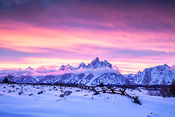 """Winter sunset, Grand Teton Park.  Undulating ridges and a buckrail fence accent a psychedelic  sky<br /> <br /> For production prints or stock photos click the Purchase Print/License Photo Button in upper Right; for Fine Art """"Custom Prints"""" contact Daryl - 208-709-3250 or dh@greater-yellowstone.com"""