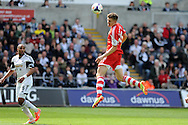 Southampton's Sam Gallagher heads over the crossbar. Barclays Premier league match, Swansea city v Southampton at the Liberty stadium in Swansea, South Wales on Saturday 3rd May 2014.<br /> pic by Andrew Orchard, Andrew Orchard sports photography.