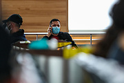 """People wearing surgical face protective masks to curb the spread of Coronavirus pandemic outbreak, wait for their flights in Terminal E2 at the Charles de Gaulle Airport in Paris, on Saturday, Dec 12, 2020. Internal European borders will remain open but external borders are closed except for essential travel. All travellers arriving in France will be tested at airports and ports says the government website adding that the """"Masks must be worn at all times in public transport"""". (VXP Photo/ Vudi Xhymshiti)"""