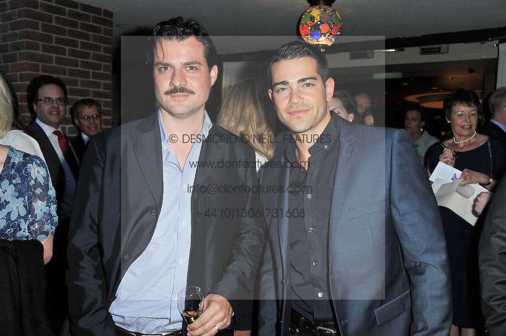 Left to right, actors JESSE METCALFE and DAN PIRRIE at the opening party of the London Syon Park - A Waldorf Astoria Hotel, Syon Park, Middlesex on 19th May 2011.