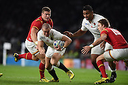 Scott Williams of Wales tries to stop Mike Brown of England.Rugby World Cup 2015 pool A match, England v Wales at Twickenham Stadium in London, England  on Saturday 26th September 2015.<br /> pic by  Andrew Orchard, Andrew Orchard sports photography.