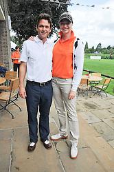DOUGRAY SCOTT and JODIE KIDD at the Mini Masters Golf tournament in aid of LEUKA - London's celebrity golf tournament held at Duke's Meadow Golf Club, Dan Mason Drive, London W4 on 17th July 2009.