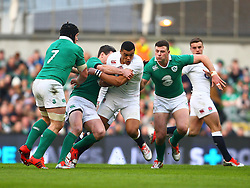 Luther Burrell, England, is tackled by Jonathan Sexton, Ireland - Photo mandatory by-line: Ken Sutton/JMP - Mobile: 07966 386802 - 01/03/2015 - SPORT - Rugby - Dublin - Aviva Stadium - Ireland v England - Six Nations