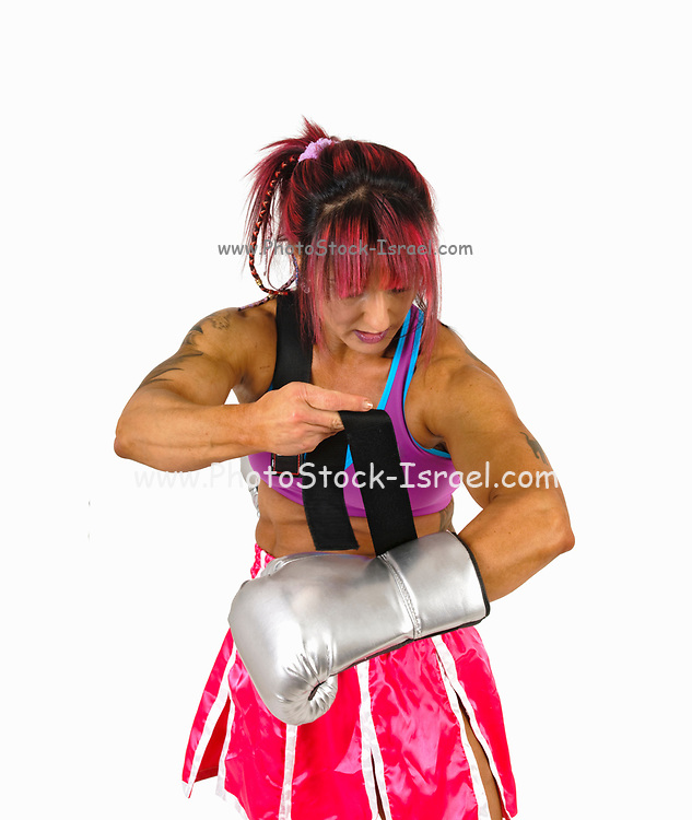 Female Kick ties her boxing gloves