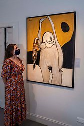 Pictured: Gallery assistant Rebecca Beatty takes in the power of Woman with Reptile (c1970) by Pat Douthwaite<br />