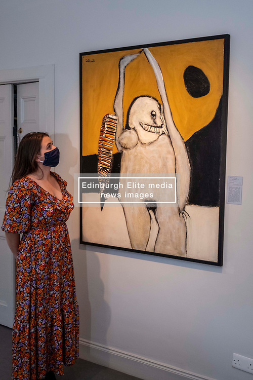 Pictured: Gallery assistant Rebecca Beatty takes in the power of Woman with Reptile (c1970) by Pat Douthwaite<br /><br />The Scottish Gallery on Dundas Street Edinburgh is putting on the Modern Masters Women exibition between 30 July and 29 August 2020.  Strict social distancing rules will apply  but there is plenty space to appreciate the works on display<br /><br />Ger Harley | EEm 28 July 2020