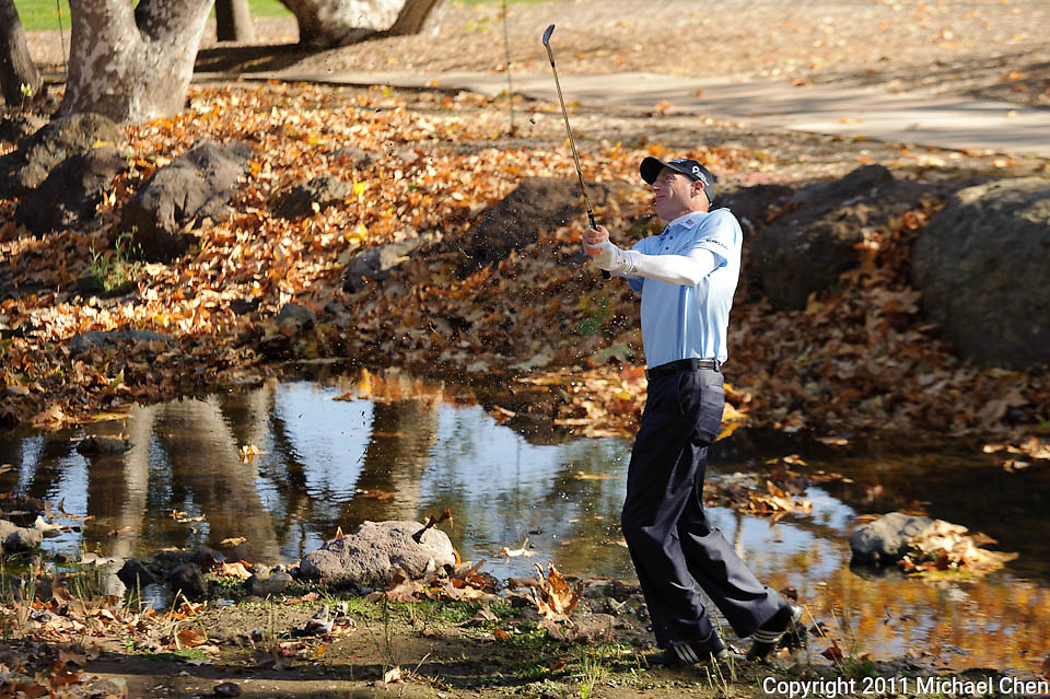 Jim Furyk hits an approach shot out of a stream on hole 1 during Round 3 of the 2011 Chevron World Challenge at the Sherwood Country Club in Thousand Oaks, Calif., on Saturday, Dec. 3, 2011.