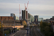 View along the train tracks into New Street Station and the development of central Birmingham, United Kingdom.