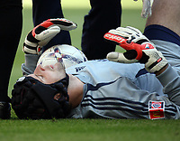 Photo: Rich Eaton.<br /> <br /> Manchester United v Chelsea. FA Community Shield. 05/08/2007. Chelsea's keeper Petr Cech lies injured after a clash with Wayne Rooney.