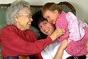 Great grandmother age 90 playing with mother and child age 29 and 1.  WesternSprings Illinois USA