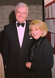 MR DAVID CROSER and singer ELAINE PAIGE, at a dinner in London on 16th January 1998.MEP 22