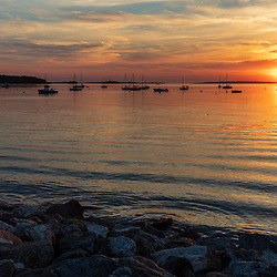 Sunrise over Casco Bay as seen from the Eastern Promenade in Portland, Maine.
