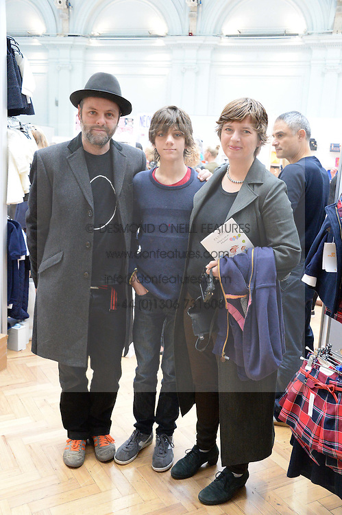 GAVIN TURK and DEBORAH CURTIS with their son CAESER TURK at the Plusher Fair, Lindley Hall, Royal Horticultural Halls, Vincent Square, London, on 9th November 2013.