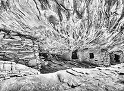 Cedar Mesa, Utah.<br /> I was waiting for the sunlight to reach the right angle and light up canyon walls that would reflect into the ceiling and bring out the fire of the sandstone vault.  Ancient peoples lived here, tucked into the fold of an alcove above a stream, in a canyon like a hundred others,in the high desert in Cedar Mesa.  I came looking for it in winter, hiking up through snow along the bottom of a wash that is in too much shadow too many hours of the day to get burned off.  Climbing up, and happy to be out of the dry chill of the canyon bottom, I warmed and shed layers in the sun on the slickrock.  No exception to other south-facing ruins (to take advantage of the sun's warmth), Flaming House Ruins--or, House on Fire as it's also called--is still intact.  Too easily found not to have been excavated by  thieves, they at least left the site intact, and we can try to imagine what life must have been like here.  I appreciate the strength to get the masonworks up here, the fortitude to live so primitively, and their taste in locations.  Because, as the light grows and throws it into relief, I realize this place  probably wouldn't even be noticed today, if not for them.
