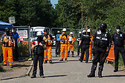 HS2 security guards stand in front of a road closure as they observe activists from HS2 Rebellion and Extinction Rebellion UK taking part in a 'Rebel Trail' hike along the route of the HS2 high-speed rail link on 26th June 2020 in Harefield, United Kingdom. The activists, who departed from Birmingham on 20th June and will arrive outside Parliament in London on 27th June, are protesting against the environmental impact of the high-speed rail link and questioning the viability of the £100bn+ project.