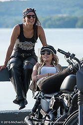 Iron Lilies Lilly James (L) and Leticia Cline out riding during Laconia Motorcycle Week 2016. NH, USA. Sunday, June 19, 2016.  Photography ©2016 Michael Lichter.