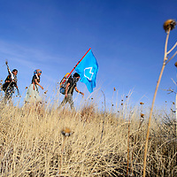012815       Cable Hoover<br /> <br /> Diné youth demonstrators march south along County Road 19 near prewitt Wednesday.